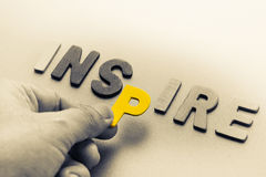 Inspire. Hand arrange wood letters as Inspire word royalty free stock photography