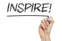 Inspire handwritten on blackboard Stock Image