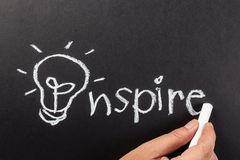 Inspire lamp. Hand drawing light bulb as symbol of Inspire word royalty free stock photo