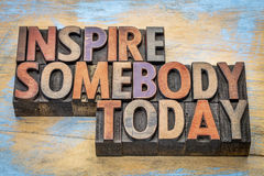 Inspire somebody today. Motivational text in vintage letterpress wood type royalty free stock photography