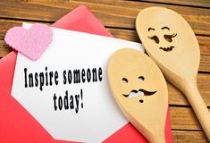 Inspire someone today!. Inspire someone today written on paper Royalty Free Stock Photos