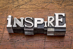 Inspire word in metal type Royalty Free Stock Image