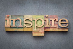 Inspire word in wood type Royalty Free Stock Image