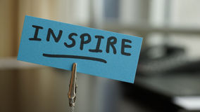 Inspire written. On a memo at the office Royalty Free Stock Images