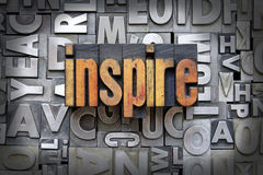 Inspire. Written in vintage letterpress type Royalty Free Stock Photos