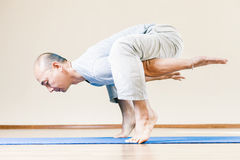 Inspired asian man doing exercise of yoga indoor Royalty Free Stock Photography