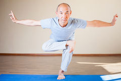 Inspired asian man doing exercise of yoga indoor Stock Photo
