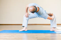 Inspired asian man doing exercise of yoga indoor Royalty Free Stock Images