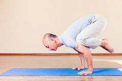 Inspired asian man doing exercise of yoga indoor Stock Photography