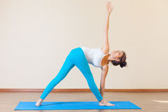 Inspired asian woman doing exercise of yoga indoor Royalty Free Stock Photography