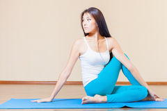 Inspired asian woman doing exercise of yoga indoor Royalty Free Stock Image