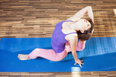 Inspired asian woman doing exercise of yoga indoor Stock Photo