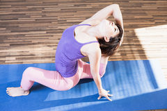 Inspired asian woman doing exercise of yoga indoor Stock Photography