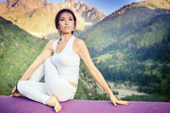 Inspired asian woman doing exercise of yoga at mountain Stock Image