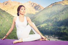 Inspired asian woman doing exercise of yoga at mountain Stock Photo