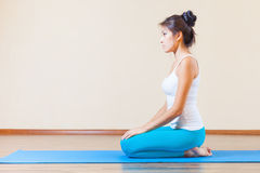 Inspired asian woman meditating before yoga exercise at home Stock Photo