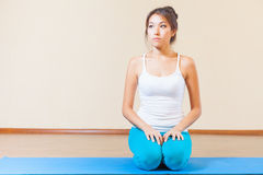 Inspired asian woman meditating before yoga exercise indoor. At class of yoga. Concept of a healthy lifestyle, sport and the right attitude to life Stock Image