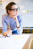 Inspired beautiful business woman working in office Royalty Free Stock Photography