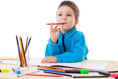 Inspired boy draw with crayons Stock Image
