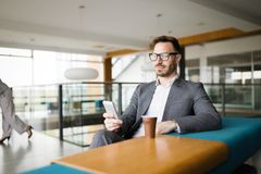 Inspired businesman sitting at coffee-break Stock Image