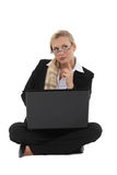 Inspired businesswoman in lotus position Stock Photo