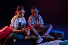 Inspired children playing with their gadgets Stock Photo