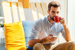 Inspired with cup of fresh coffee. Stock Photography