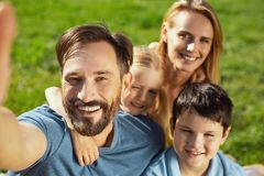 Inspired father taking selfies with his family Royalty Free Stock Images
