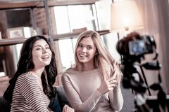 Inspired female vloggers recording a video stock photos