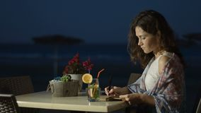 Inspired female writer making notes in notebook, working on romantic love story. Stock footage stock footage