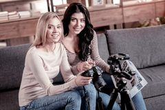 Inspired friends sitting on the couch stock photography