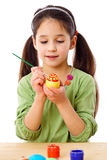 Inspired girl paint easter eggs Stock Image