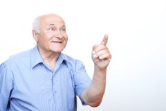 Inspired grandfather pointing with index finger Stock Image