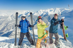 Inspired group of snowboarders at summit Stock Photos