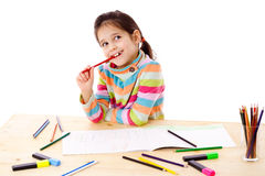Inspired little girl draw with crayons Royalty Free Stock Photography