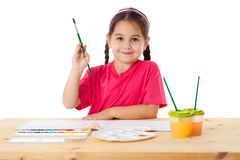 Inspired little girl with paintbrush Royalty Free Stock Photography
