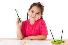 Inspired little girl with paintbrush Royalty Free Stock Photos