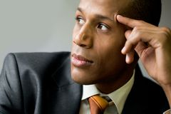 Inspired man. Pensive employee thinking of new ideas and looking aside Stock Photo