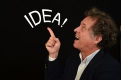 Inspired Man. Man looking with amazement at the word idea Stock Photography