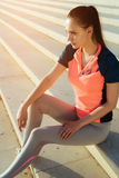 Inspired motivated young jogger female.Woman runner resting Stock Photos