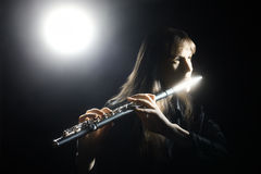 Inspired musician fine art photo. Flute player. Flutist with classical musical instrument Royalty Free Stock Photo
