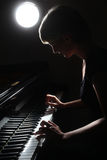 Inspired musician fine art photo. Piano player. Pianist with grand piano classical musical instrument Royalty Free Stock Images