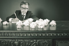 Inspired school boy writing essay or exam Royalty Free Stock Image
