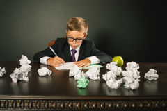 Inspired school boy writing essay or exam Royalty Free Stock Photos
