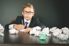 Inspired school boy writing essay or exam Royalty Free Stock Images