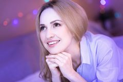 Inspired smiling young lady dreaming. My dream. Attractive dark-eyed thoughtful woman smiling and feeling happy while dreaming of something Royalty Free Stock Images