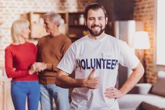 Inspired volunteer showing his thumb up royalty free stock photos