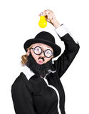 Inspired Woman Dressed As Man Holding Bulb. Inspired And Innovative Woman Dressed As A Male Holding Yellow Light Bulb Royalty Free Stock Photography