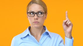 Inspired woman in formal wear putting finger up, having idea, business strategy stock footage