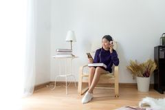 Inspired young asian woman listening the music at home, relax and happy life. stock photo